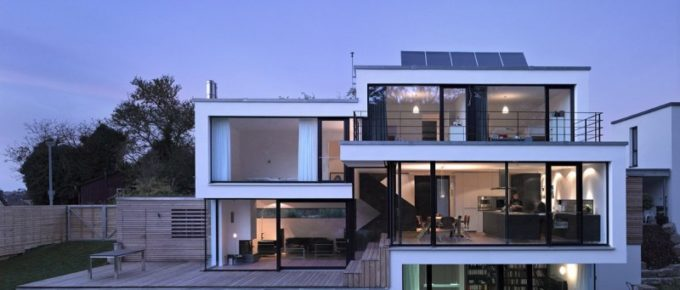 The Key Benefits of Glass Wall House Designs
